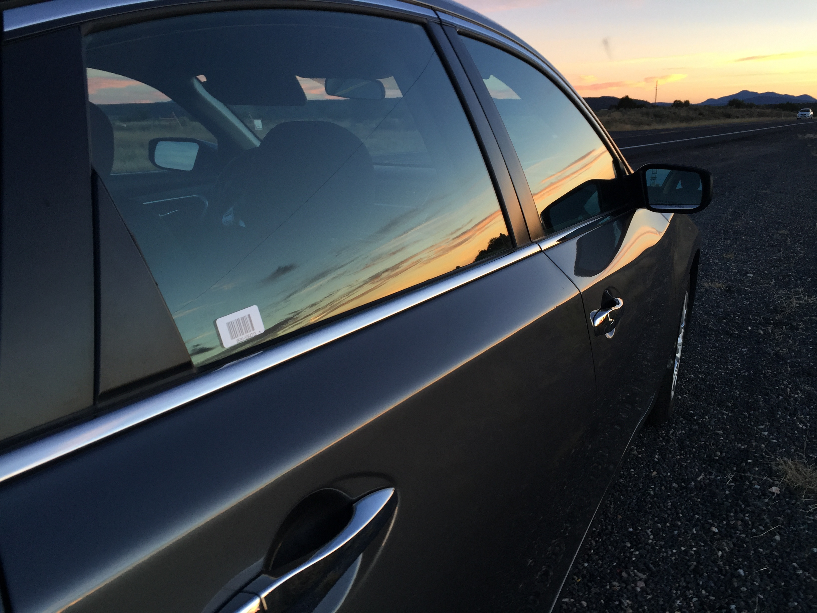 img_2164-nissan-altima-hire-car-with-sunset-reflection